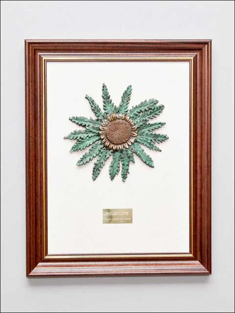 Figuras de bronce para colgar. Eguzkilore-1