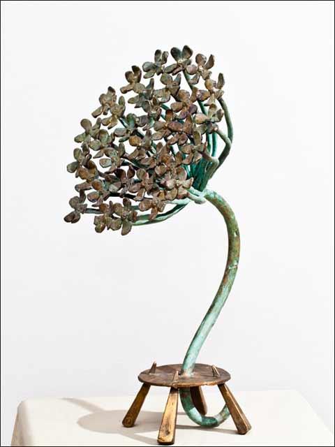 Figura de bronce. Milflores.
