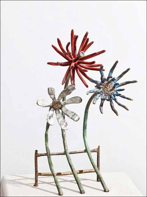 figuras decoracion salon - flores de bronce - flores observadoras