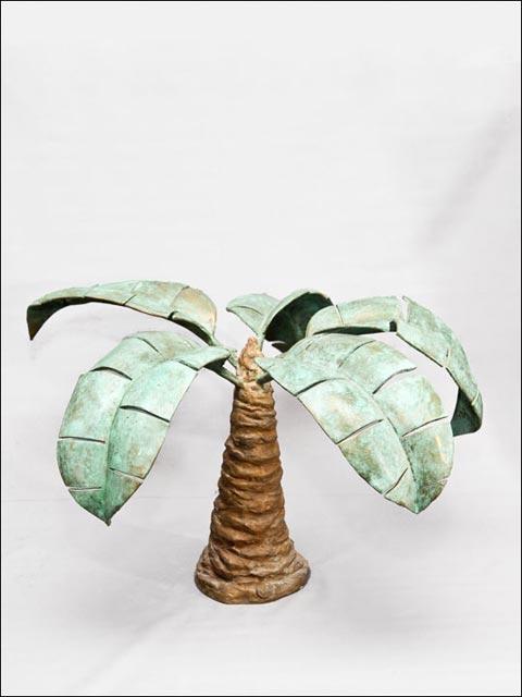 Figuras de bronce. Palmera tropical.